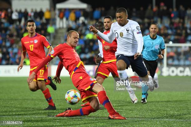 Kylian Mbappe of France battles for possession with Ildefons Lima of Andorra during the UEFA Euro 2020 Qualification match between Andorra and France...