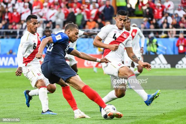 Kylian Mbappe of France between Miguel Trauco and Anderson Santamaria of Peru during the FIFA World Cup match Group C match between France and Peru...