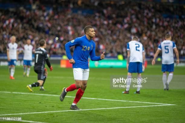 Kylian Mbappe of France celebrates after beating goalkeeper Hannes Por Halldorsson of Iceland to score during the France V Iceland 2020 European...