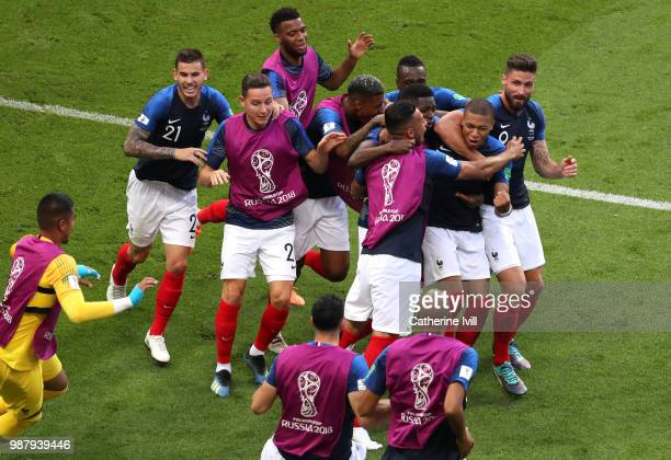 Kylian Mbappe of France celebrates after scoring his side's fourth goal with team mates during the 2018 FIFA World Cup Russia Round of 16 match...