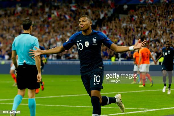 Kylian Mbappe of France celebrates after scoring his team`s first goal during the UEFA Nations League A group one match between France and...