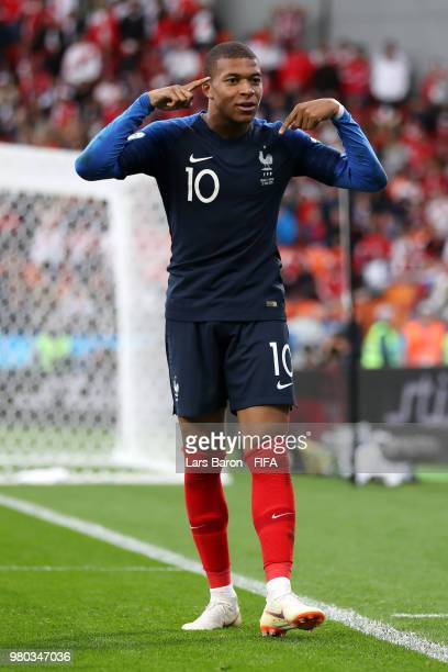 Kylian Mbappe of France celebrates after scoring his team's first goal during the 2018 FIFA World Cup Russia group C match between France and Peru at...