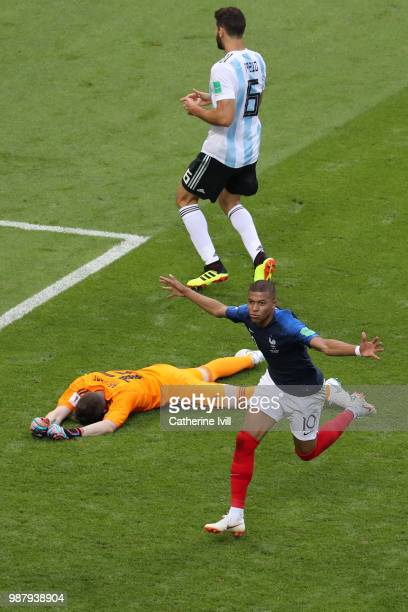Kylian Mbappe of France celebrates after scoring his team's fourth goal as Franco Armani of Argentina looks dejected during the 2018 FIFA World Cup...