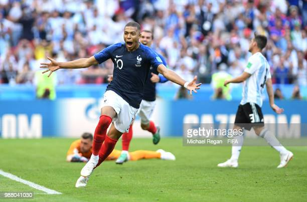 Kylian Mbappe of France celebrates after scoring his team's fourth goal during the 2018 FIFA World Cup Russia Round of 16 match between France and...