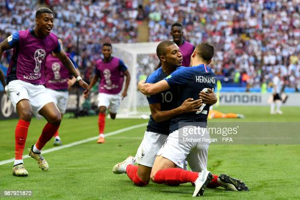 Kylian Mbappe of France celebrates after scoring his team's third goal with team mates during the 2018 FIFA World Cup Russia Round of 16 match...