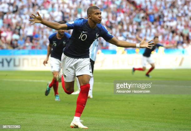 Kylian Mbappe of France celebrates after scoring his team's third goal during the 2018 FIFA World Cup Russia Round of 16 match between France and...