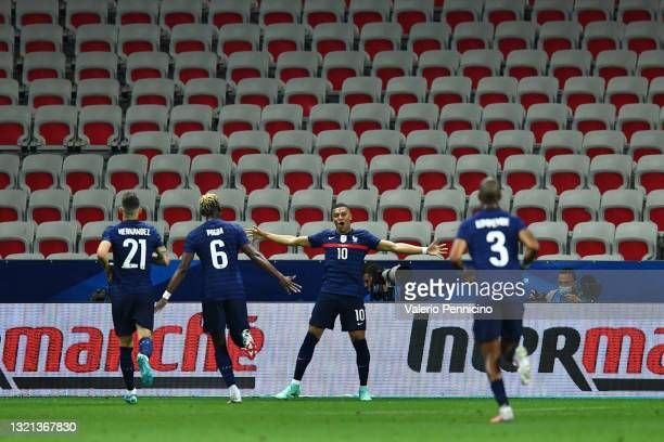 Kylian Mbappe of France celebrates after scoring their sides first goal with team mates Lucas Hernandez, Paul Pogba and Presnel Kimpembe of France...