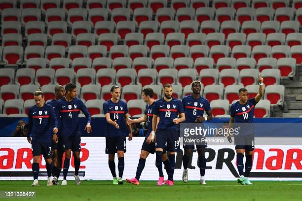 Kylian Mbappe of France celebrates after scoring their sides first goal during the international friendly match between France and Wales at Allianz...