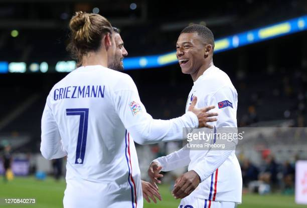 Kylian Mbappe of France celebrates with Antoine Griezmann after scoring his team's first goal during the UEFA Nations League group stage match...
