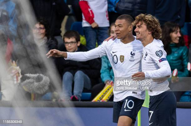 Kylian Mbappe of France celebrates with Antoine Griezmann of France after scoring his team's first goal during the UEFA Euro 2020 Qualifier Group H...