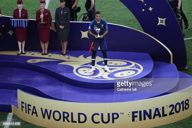 Kylian Mbappe of France celebrates with his Best Young Player Award following the 2018 FIFA World Cup Final between France and Croatia at Luzhniki...
