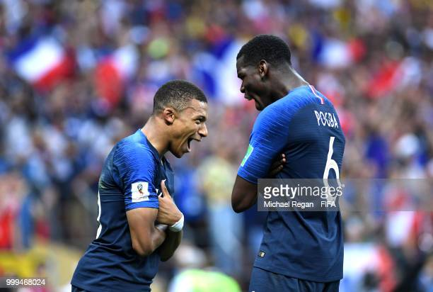 Kylian Mbappe of France celebrates with team mate Paul Pogba after scoring his team's fourth goal during the 2018 FIFA World Cup Final between France...