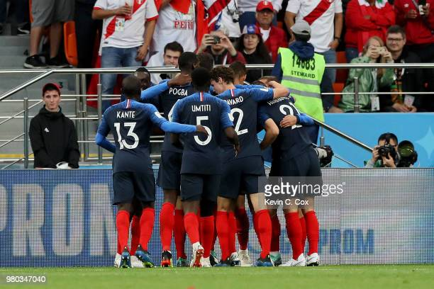 Kylian Mbappe of France celebrates with team mates after scoring his team's first goal during the 2018 FIFA World Cup Russia group C match between...