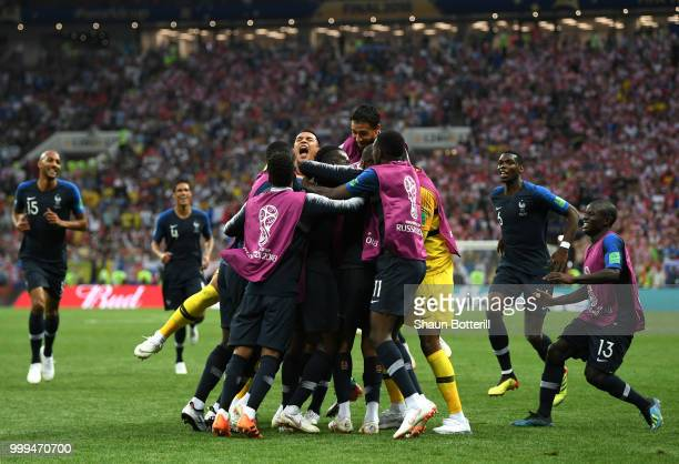 Kylian Mbappe of France celebrates with team mates after scoring his team's fourth goal during the 2018 FIFA World Cup Final between France and...