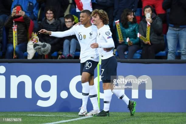 Kylian Mbappe of France celebrates with teammate Antoine Griezmann of France after scoring his team's first goal during the UEFA Euro 2020...