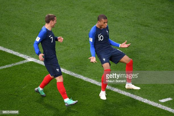 Kylian Mbappe of France celebrates with teammate Antoine Griezmann after scoring his team's first goal during the 2018 FIFA World Cup Russia group C...