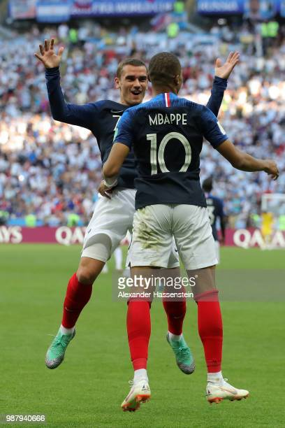 Kylian Mbappe of France celebrates with teammate Antoine Griezmann after scoring his team's third goal during the 2018 FIFA World Cup Russia Round of...