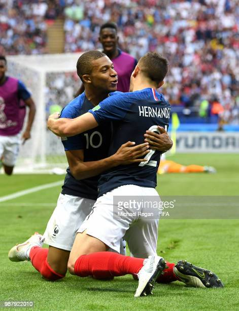 Kylian Mbappe of France celebrates with teammate Lucas Hernandez after scoring his team's third goal during the 2018 FIFA World Cup Russia Round of...