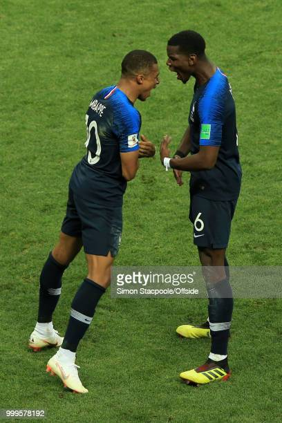Kylian Mbappe of France celebrates with teammate Paul Pogba after scoring their 4th goal during the 2018 FIFA World Cup Russia Final between France...