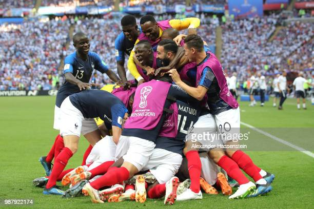 Kylian Mbappe of France celebrates with teammates after scoring his team's third goal during the 2018 FIFA World Cup Russia Round of 16 match between...