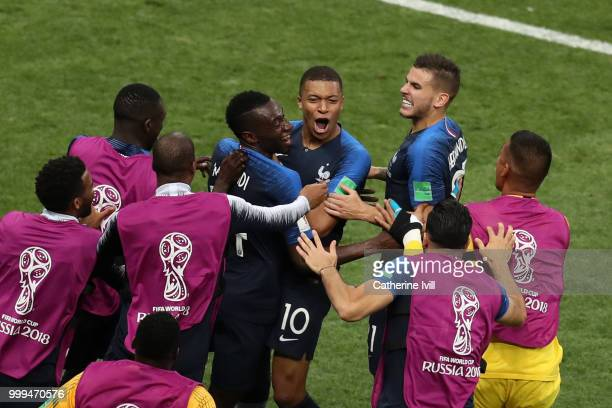 Kylian Mbappe of France celebrates with teammates after scoring his team's fourth goal during the 2018 FIFA World Cup Final between France and...