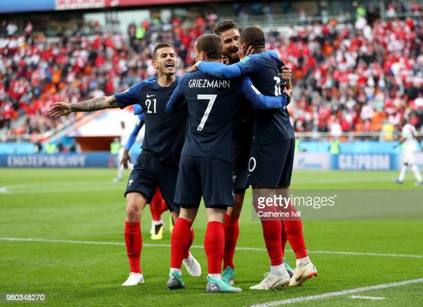 Kylian Mbappe of France celebrates with teammates Antoine Griezmann Olivier Giroud and Lucas Hernandez after scoring his team's first goal during the...