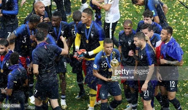 Kylian Mbappe of France celebrates with the World Cup trophy following the 2018 FIFA World Cup Final between France and Croatia at Luzhniki Stadium...