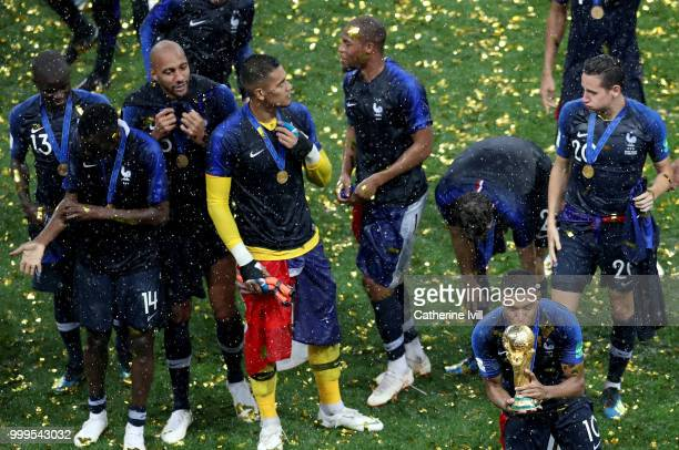 Kylian Mbappe of France celebrates with the World Cup trophy with team mates following the 2018 FIFA World Cup Final between France and Croatia at...