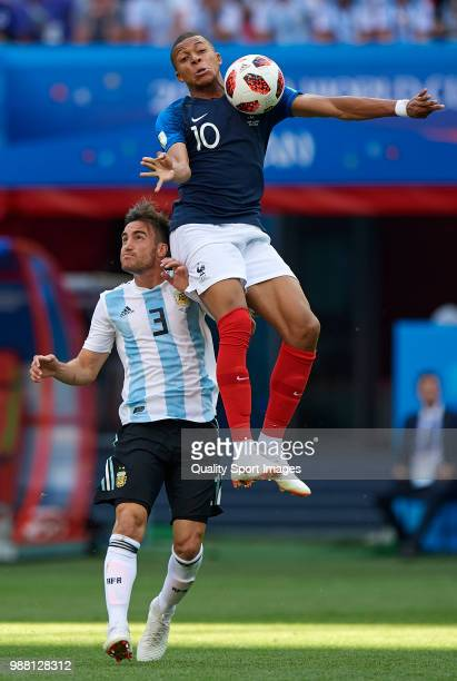 Kylian Mbappe of France comeptes for the ball with Nicolas Tagliafico of Argentina during the 2018 FIFA World Cup Russia Round of 16 match between...