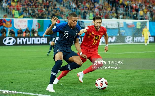Kylian Mbappe of France competes for the ball with Yannick Carrasco of Belgium during the 2018 FIFA World Cup Russia Semi Final match between Belgium...