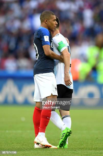 Kylian Mbappe of France consoles Lionel Messi of Argentina during the 2018 FIFA World Cup Russia Round of 16 match between France and Argentina at...