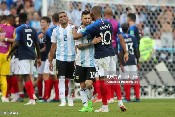 Kylian Mbappe of France consoles Lionel Messi of Argentina following France's victory in the 2018 FIFA World Cup Russia Round of 16 match between...
