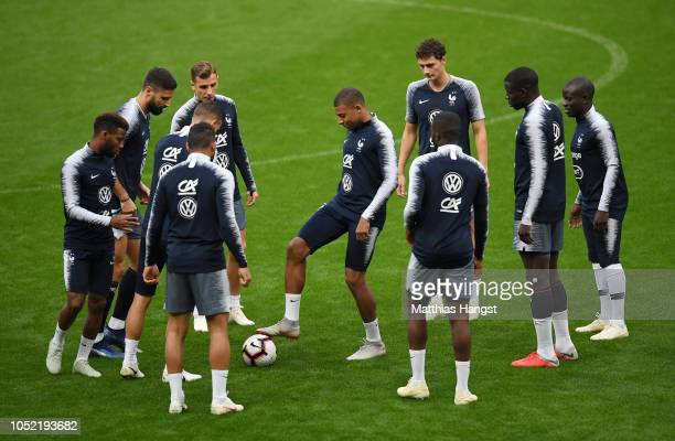 Kylian Mbappe of France controls the ball during a France training session at Stade de France on October 15 2018 in Paris France