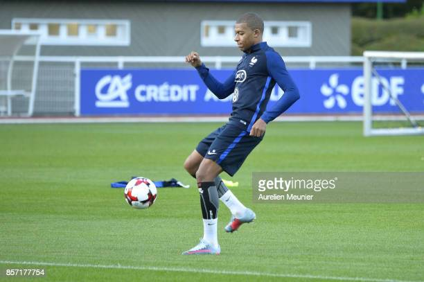 Kylian Mbappe of France controls the ball during a France training session on October 3 2017 in Clairefontaine France