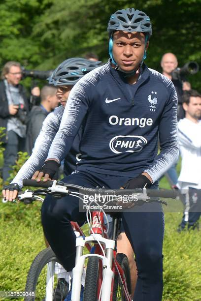 Kylian Mbappe of France drives a bicycle during the VTT session for the first training at the National Football Centre as part of the preparation to...