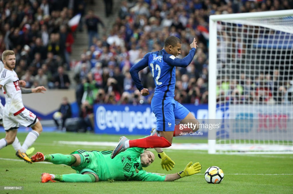 Kylian Mbappe of France, goalkeeper of Belarus Sergey Chernik during the FIFA 2018 World Cup Qualifier between France and Belarus at Stade de France on October 10, 2017 in Saint Denis, France.
