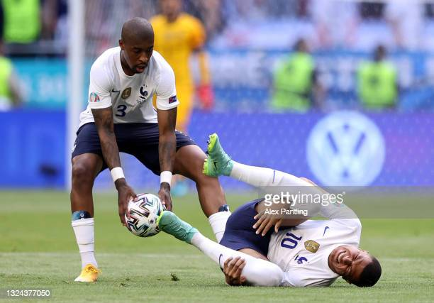 Kylian Mbappe of France goes down as he appears to be injured during the UEFA Euro 2020 Championship Group F match between Hungary and France at...