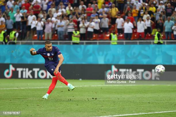 Kylian Mbappe of France has their side's decisive penalty saved by Yann Sommer of Switzerland during the UEFA Euro 2020 Championship Round of 16...
