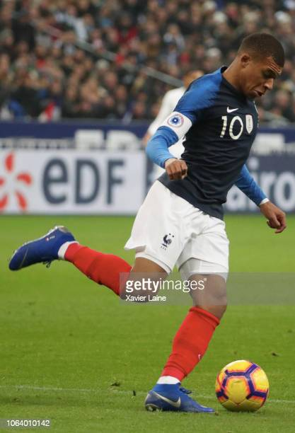 Kylian Mbappe of France in action with Luis Suarez of Uruguay during the International Friendly match between France and Uruguay at Stade de France...