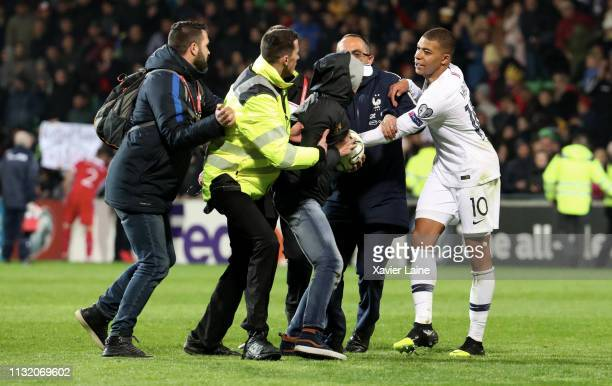 Kylian Mbappe of France intervenes so that the security is not violent with the streaker during the 2020 UEFA European Championships Group H...