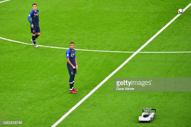 Kylian Mbappe of France is amused by the remote control car that delivers the matchball for the Nations League match between France and Germany at...