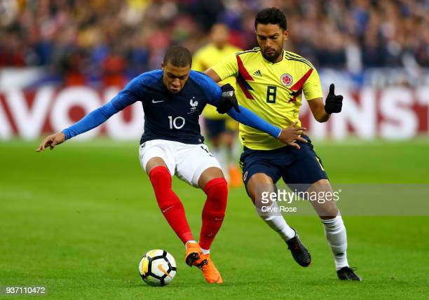 Kylian Mbappe of France is challenged by Abel Aguilar of Columbia during the International friendly match between France and Columbia at Stade de...