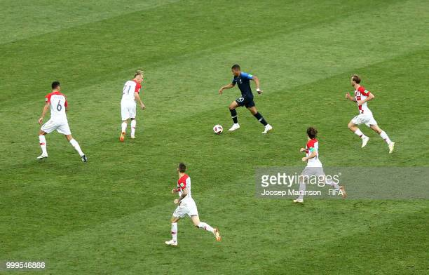 Kylian Mbappe of France is challenged by Domagoj Vida Dejan Lovren Ivan Rakitic and Luka Modric during the 2018 FIFA World Cup Final between France...