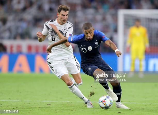 Kylian Mbappe of France is challenged by Leon Goretzka of Germany during the UEFA Nations League Group A match between Germany and France at Allianz...