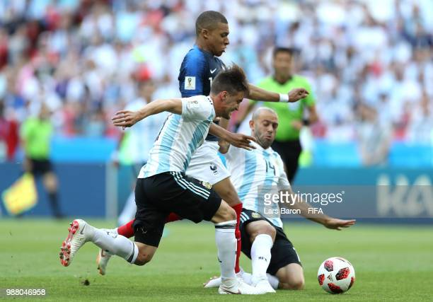 Kylian Mbappe of France is challenged by Nicolas Tagliafico of Argentina and Javier Mascherano of Argentina during the 2018 FIFA World Cup Russia...