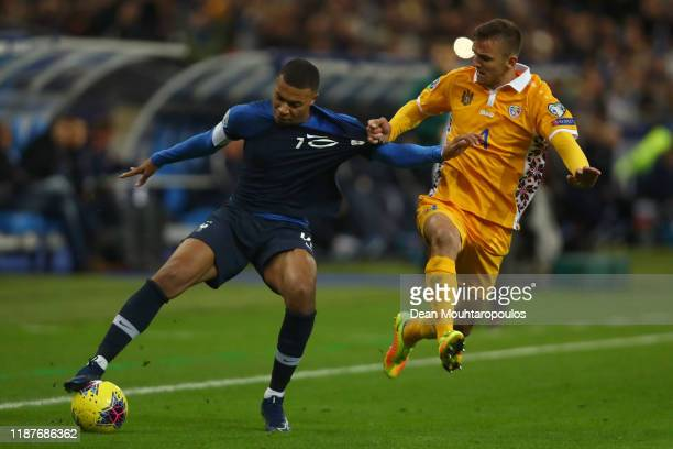 Kylian Mbappe of France is challenged by Sergiu Platica of Moldova during the UEFA Euro 2020 Qualifier between France and Moldova on November 14 2019...