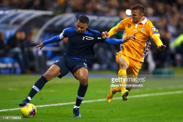 Kylian Mbappe of France is challenged by Sergiu Platica of Moldova during the UEFA Euro 2020 Qualifier between France and Moldova held at Stade de...