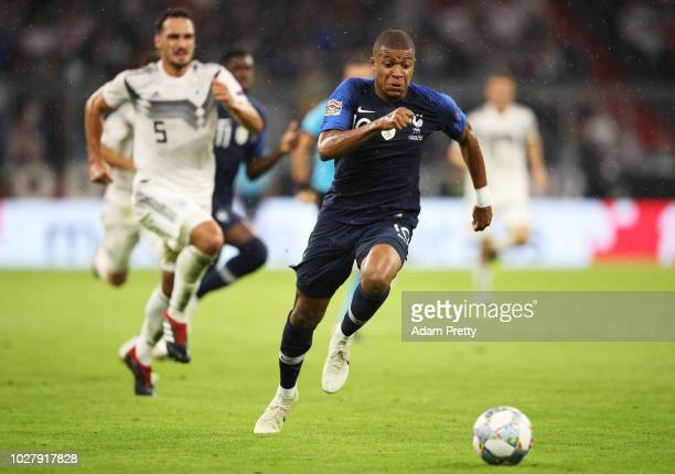 Kylian Mbappe of France is chased by Mats Hummels of Germany during the UEFA Nations League group A match between Germany and France at Allianz Arena...