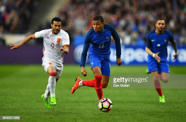 Kylian Mbappe of France is closed down by Pedro of Spain during the International Friendly match between France and Spain at Stade de France on March...
