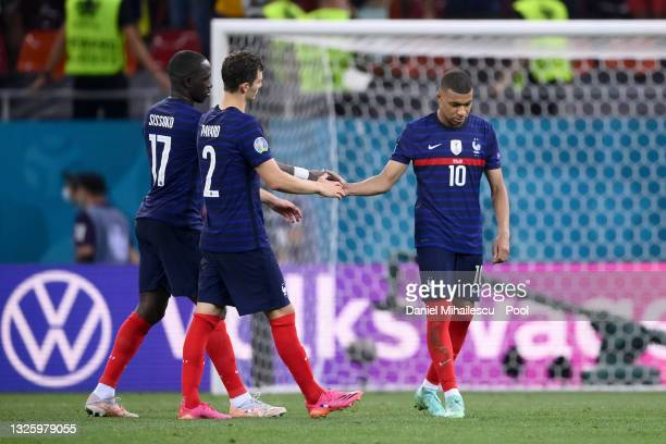 Kylian Mbappe of France is consoled by teammates Moussa Sissoko and Benjamin Pavard after taking the decisive penalty that was saved by Yann Sommer...